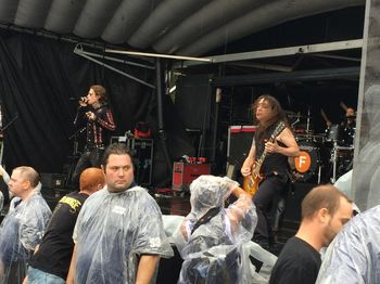 Buckcherry and rain-dampened security personnel